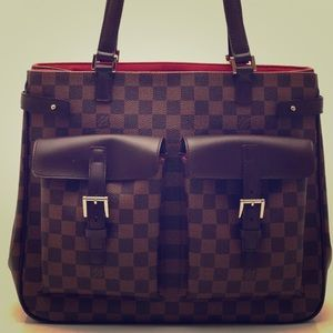 Authentic new condition Louis Vuitton Uzes Bag